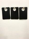 Puste czerni etykietki Na biel ścianie Obrazy Stock