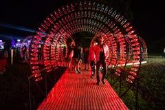 Puste koka-kola butelki układają i iluminują z czerwonym li Obrazy Royalty Free