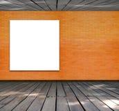 Puste miejsce rama na ściana z cegieł i drewna podłoga Zdjęcie Stock