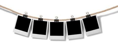 Puste natychmiastowe fotografie wiesza na clothesline obrazy stock