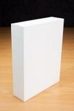Pusty białego pudełka egzamin próbny up na drewnie Zdjęcie Stock