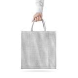 Pusty biały bawełniany eco torby projekta mockup, trzyma rękę zdjęcie royalty free
