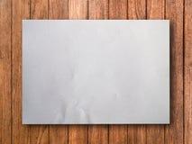 Pusty Biały papier na drewnie zdjęcia stock