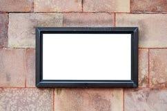 Pusty billboard na kamiennej ścianie zdjęcie stock