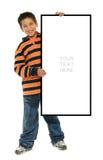 pusty chłopiec trzymający znak Fotografia Royalty Free