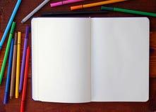 Pusty notatnik i ołówki obrazy stock
