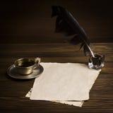 Pusty papier, filiżanka kawy, dutka i atrament, obraz stock