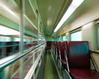 Pusty pociągu pasażerskiego samochód z ruch plamą zdjęcia royalty free