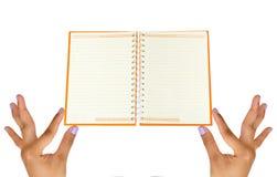 pusty ręki mienia notatnik Fotografia Stock