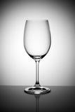 pusty wina szkło na świetle - szary tło Fotografia Royalty Free