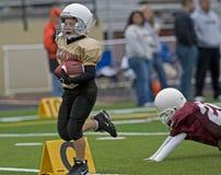 puszka futbolowa dotyka młodość Obraz Royalty Free