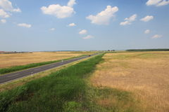 The Puszta. Road passing through the Great Hungarian Plain Stock Photography