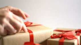 Put and arrange Christmas gift box on white background.  stock video footage
