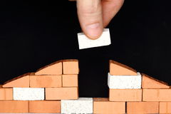 Put a brick in a wall. Of a house Royalty Free Stock Images