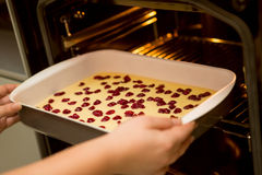 Put the cake in the oven, Cherry sponge  cake Royalty Free Stock Image