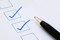 Put the check mark/tick in the boxes. Concepts of approval and correctness royalty free stock image