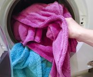 Put the cloth in the washer. Domestic Stock Photo