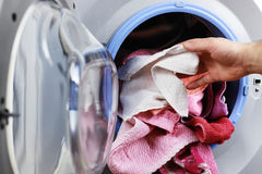 Put cloth in washer royalty free stock photo