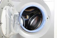 Put cloth in washer stock images
