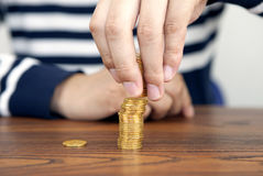 Put coins, investor Royalty Free Stock Image