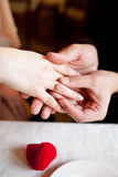 Put on engagement ring Stock Images