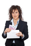Put euros bills on the envelope. Businesswoman put euros bills on the envelope over a white background Stock Images