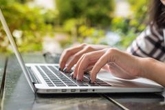 Put fingers on the keyboard of laptop. With blur background Stock Images