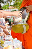 Put food offerings in a Buddhist monk's alms bowl Stock Photos