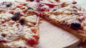 Put freshly baked pizza in the plate. 1920x1080 stock footage