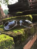 Put glasses on bricks in the ancient. royalty free stock image