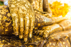Put gold leaf onto The Buddha statue to gild. Which people use t. O worship the buddha image stock photos