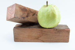 Put the guava on the Timber. Put guava on two timber Stock Images