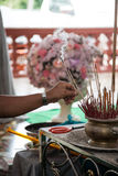 Put the joss stick in the bowl Royalty Free Stock Photos