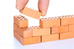Put in the last brick. In a wall Stock Photo