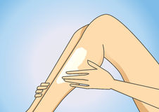 Put on leg lotion Stock Images