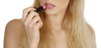 Put on lipstick Royalty Free Stock Photography