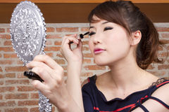 Put on make up Stock Images