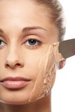 Put on makeup foundation with spatula Royalty Free Stock Photo