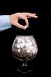 Put money into glass Royalty Free Stock Photos