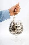 Put money into glass Royalty Free Stock Photography