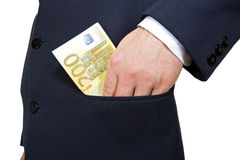 Put the money int he pocket Royalty Free Stock Photos