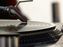 Put the needle on the record. A needle on a spinning record Royalty Free Stock Images