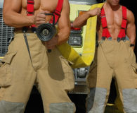Put out the fire. Male firefighters Royalty Free Stock Photo