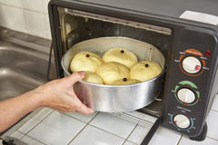 Put into oven. Put the bread dough on tray to the oven Royalty Free Stock Photos