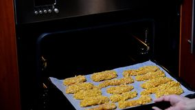 Put in the oven to bake chicken strips. HD stock video footage