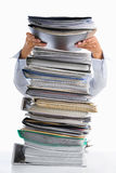 Put paper into high pile paperwork Stock Photography
