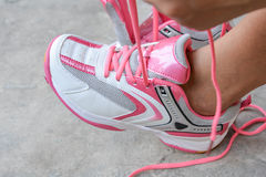 Put on the pink sport shoes Stock Images