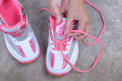 Put on the pink sport shoes Stock Photos