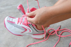 Put on the pink sport shoes Royalty Free Stock Image