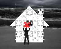 Put red puzzle into house shape for bad situation Royalty Free Stock Images